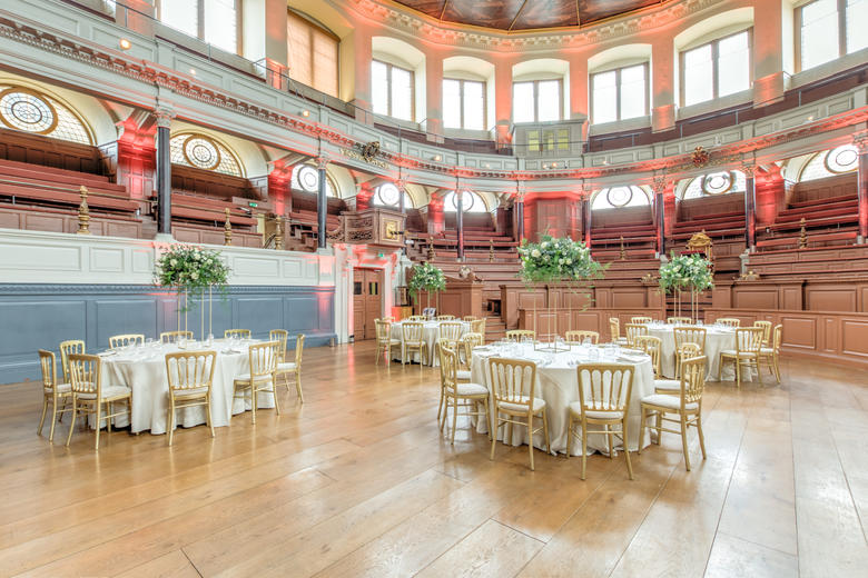 Photo of the Sheldonian Theatre with tables set up for a wedding