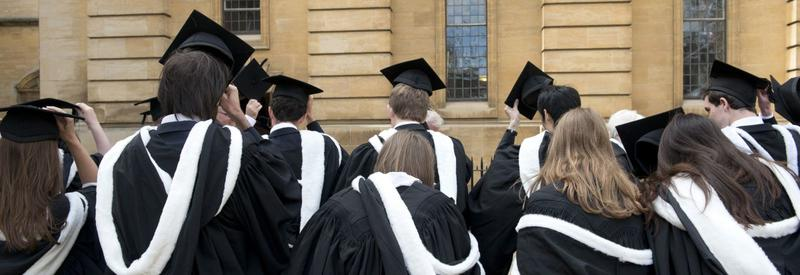 Photo of students in caps and gowns entering the Sheldonian Theatre for their degree ceremony